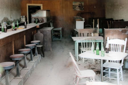 Empty tables and chairs in a bar, Bodie Ghost Town, Bodie State Historic Park, Mono County, California, USA