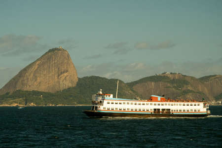 Ferry boat called Barca in front of Sugarloaf Mountain, Rio De Janeiro, Brazil Stock Photo
