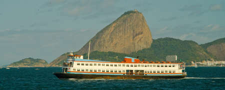 Ferry boat called Barca in front of Sugarloaf Mountain, Rio De Janeiro, Brazil photo
