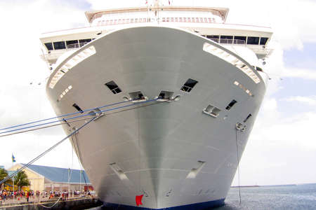 cruiser: A cruise ship moored in the harbor.