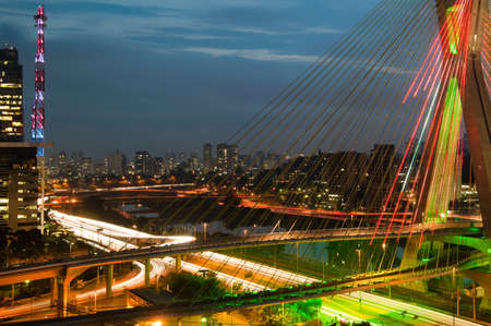 Most famous bridge in the city at dusk, Octavio Frias De Oliveira Bridge, Pinheiros River, Sao Paulo, Brazil Stock Photo