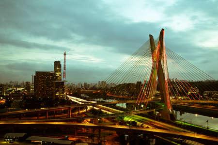 Most famous bridge in the city at dusk, Octavio Frias De Oliveira Bridge, Pinheiros River, Sao Paulo, Brazil Publikacyjne