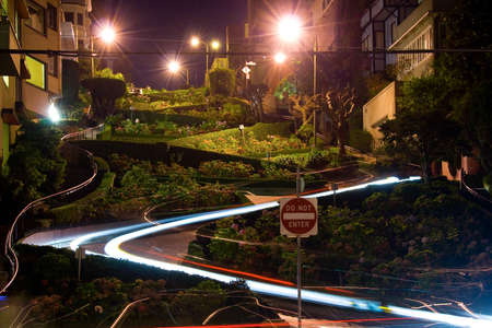 Scenic view of Lombard street at night with colorful lights of driving cars, San Francisco, U.S.A. photo