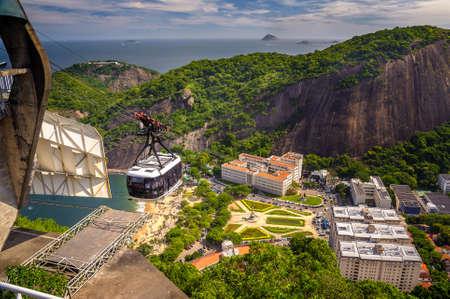 Cable car moving over a residential area, Urca, Rio de Janeiro, Brazil