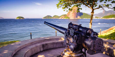 Cannon at the terrace of a fort with Sugarloaf Mountain in the background, Santa Cruz Fortress, Guanabara Bay, Niteroi, Rio de Janeiro, Brazil