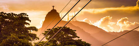 Metal cables with the Christ The Redeemer statue in the background, Corcovado, Rio de Janeiro, Brazil Stock Photo