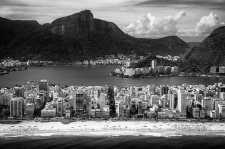 beach front: Aerial view of buildings on the beach front with a mountain range in the background, Ipanema Beach, Rio De Janeiro, Brazil