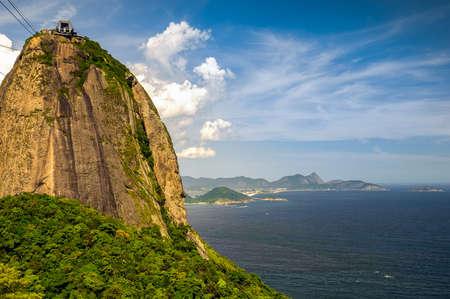 nature photography: Overhead cable car approaching Sugarloaf Mountain, Guanabara Bay, Rio De Janeiro, Brazil Stock Photo