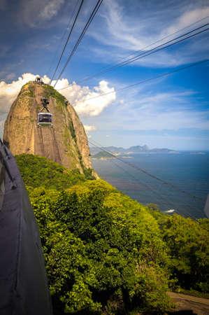 trees photography: Overhead cable car approaching Sugarloaf Mountain, Guanabara Bay, Rio De Janeiro, Brazil Stock Photo