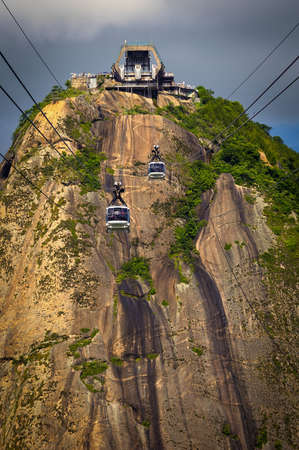 Overhead cable car approaching Sugarloaf Mountain, Guanabara Bay, Rio De Janeiro, Brazil photo