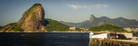 Fort at the waterfront with Sugarloaf Mountain in the background, Guanabara Bay, Rio De Janeiro, Brazil photo