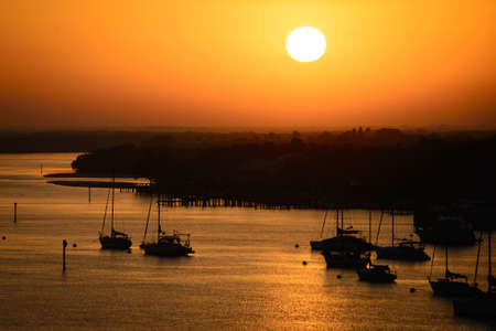 myers: Silhouette of boats in the Atlantic ocean, Fort Myers, Lee County, Florida, USA Stock Photo