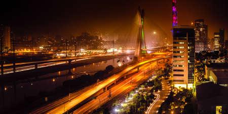 Most famous bridge in the city at night, Octavio Frias De Oliveira Bridge, Pinheiros River, Sao Paulo, Brazil
