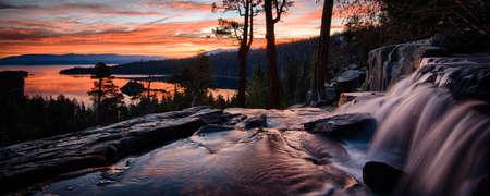 Water falling into a lake, Lake Tahoe, Sierra Nevada, California, USA Banco de Imagens