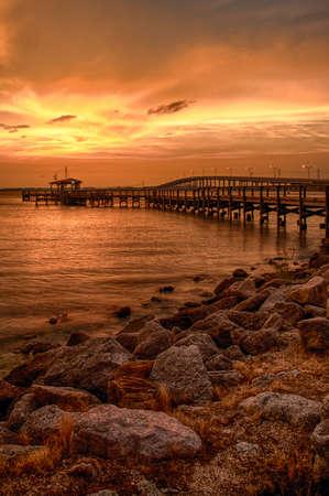 water's edge: Silhouette of a pier in the Atlantic ocean, Merritt Island, Brevard County, Florida, USA Stock Photo