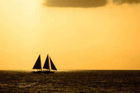 Silhouette of sailing ship in the Atlantic ocean, Key West, Monroe County, Florida, USA photo