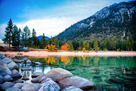 Freshwater lake with mountain in the background, Lake Tahoe, Sierra Nevada, California, USA photo