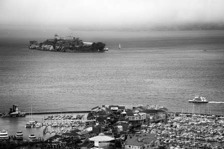 coit tower: Alcatraz and the Pier 39 as seen from the Coit Tower, San Francisco, California, USA Editorial