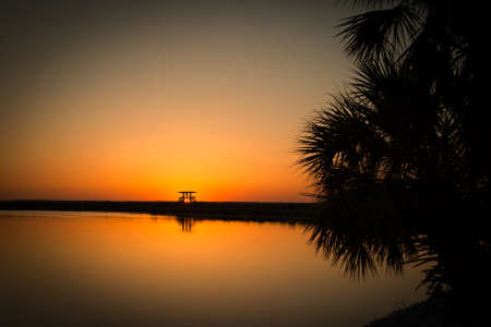 Lake at sunset, Black Point Wildlife Drive, Merritt Island National Wildlife Refuge, Titusville, , USA photo