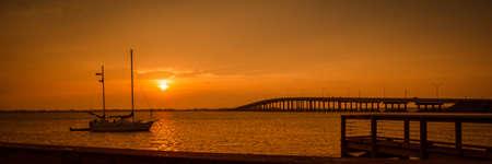 Lake at sunset, Black Point Wildlife Drive, Merritt Island National Wildlife Refuge, Titusville, Florida, USA photo