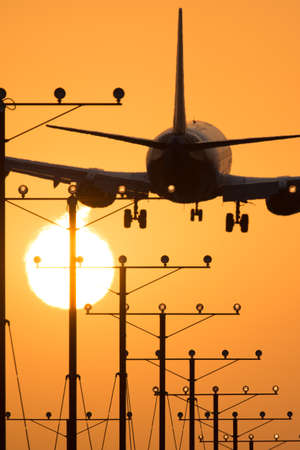 airplane landing: Airplane landing at Los Angeles International Airport during sunset, Los Angeles, California, USA