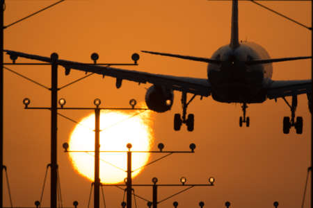 Airplane landing at Los Angeles International Airport during sunset, Los Angeles, California, USA photo