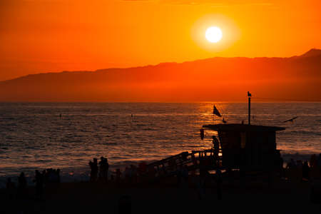 Silhouette of a lifeguard hut on the beach at dusk, Santa Monica Beach, Santa Monica, Los Angeles County, California, USA photo