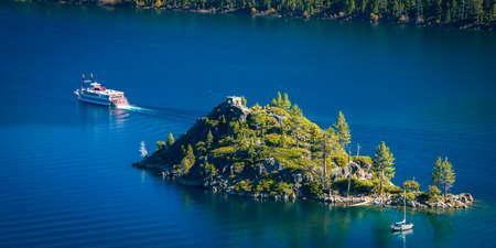 Trees on an island in a lake, Emerald Bay, Lake Tahoe, California, USA photo