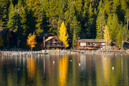 Reflection of trees on water, Carnelian Bay, Lake Tahoe, California, USA Stock Photo
