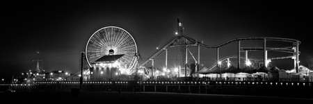 Ferris wheel on Santa Monica Pier lit up at dusk, Santa Monica, Los Angeles County, California, USA Stock Photo