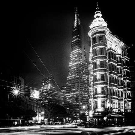 transamerica: Buildings lit up at night in a city, Columbus Tower, Transamerica Pyramid, San Francisco, California, USA Stock Photo