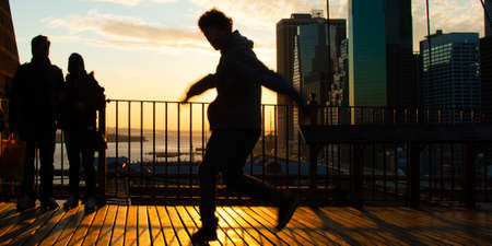 Man dancing on terrace at sunset, Midtown, Manhattan, New York City, New York State, USA photo