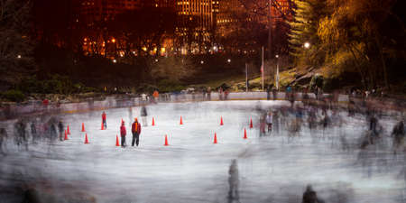 incidental people: Ice skating at Wollman Rink in Central Park, New York City, USA Stock Photo