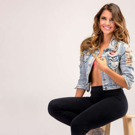 stool: Portrait of a happy beautiful young woman posing Stock Photo