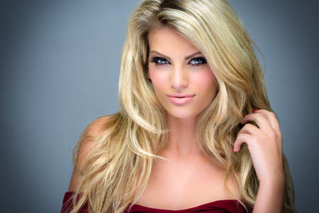 blond hair: Image of an attractive young woman posing