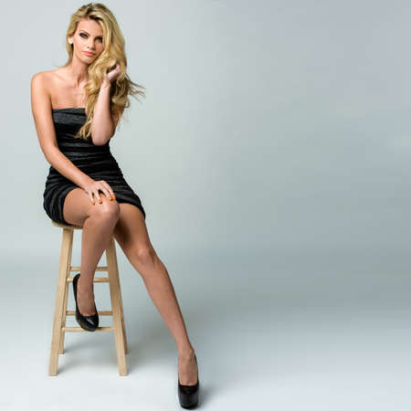 stool: Image of an attractive young woman posing