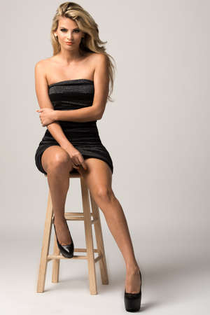 stools: Image of an attractive young woman posing