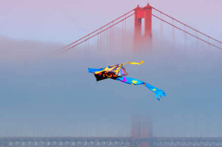 Flying Kyte with the Golden Gate on the background Stock Photo