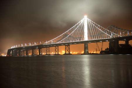 View of the Bay Bridge lit up at night, San Francisco, North Beach, California, USA Standard-Bild