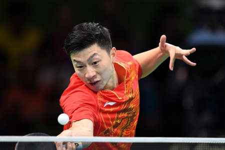 Rio, Brazil, 11 august 2016: The table tennis player Long MA (CHN) when playing against Jun MIZUTANI  (JPN) during Olympic Games Rio 2016 at Riocentro Editorial