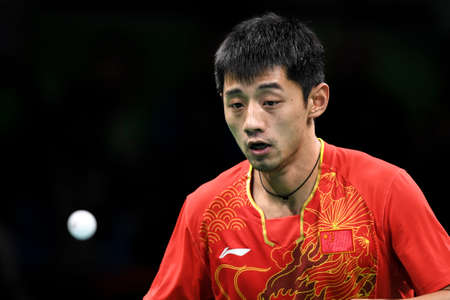 Rio, Brazil, 11 august 2016: The table tennis player Jike ZHANG (CHN) when playing against Vladimir SAMSONOV (BLR) during Olympic Games Rio 2016 at Riocentro