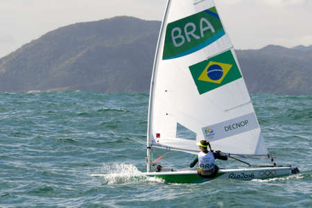 Rio, Brazil - august 12, 2016: Fernanda DECNOP (BRA) in the Laser Women category during the Rio 2016 Olympic Games Sailing held at Marina da Gloria, Guanabara Bay Editorial