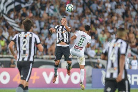 Rio, Brazil - november 04, 2017: Rodrigo Lindoso and Douglas player in match between Botafogo and  Fluminense by the Brazilian Championship in Nilton Santos Stadium