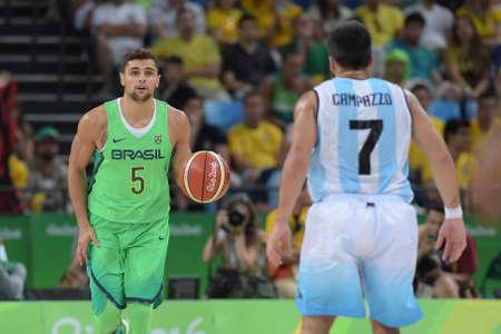 Rio, Brazil - august 13, 2016: Raulzinho NETO (BRA) during basketball game Brazil (BRA) vs Argentina (ARG) in Arena Carioca 1 in the Olympics Rio 2016 Editorial