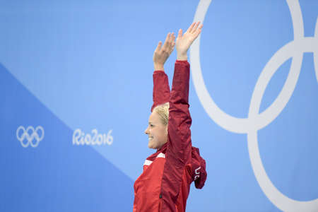 Rio de Janeiro, Brazil - august 13, 2016: Pernille Blume (DEN) gold metal during medal ceremony after womens 50 metre freestyle of the Rio 2016 Olympics Editorial