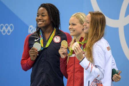 Rio de Janeiro, Brazil - august 13, 2016: Simone Manuel (L) (USA), Pernille Blume (DEN) (C) and Aliaksandra Herasimenia (R) (BLR) during medal ceremony after Womens 50 metre freestyle of the Rio 2016 Olympics Sajtókép