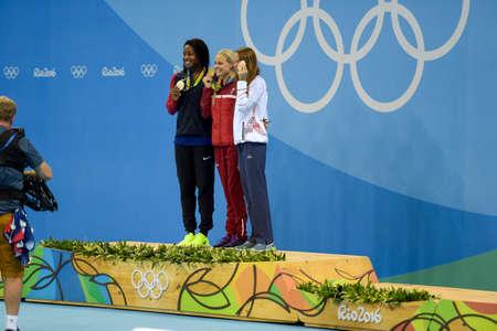 Rio de Janeiro, Brazil - august 13, 2016: Simone Manuel (L) (USA), Pernille Blume (DEN) (C) and Aliaksandra Herasimenia (R) (BLR) during medal ceremony after womens 50 metre freestyle of the Rio 2016 Olympics