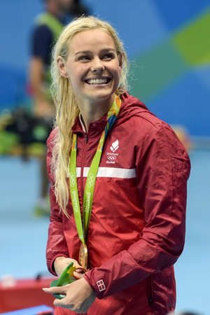 piscina olimpica: Rio de Janeiro, Brazil - august 13, 2016: Pernille Blume (DEN) gold metal during medal ceremony after Womens 50 metre freestyle of the Rio 2016 Olympics