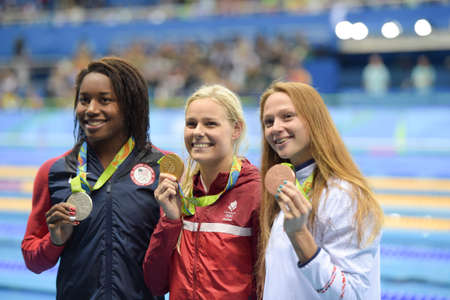 Rio de Janeiro, Brazil - august 13, 2016: Simone Manuel (L) (USA), Pernille Blume (DEN) (C) and Aliaksandra Herasimenia (R) (BLR) during medal ceremony after Womens 50 metre freestyle of the Rio 2016 Olympics Editorial