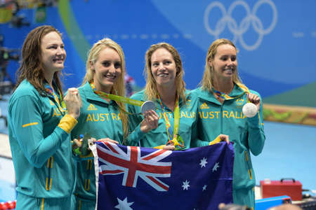 Rio de Janeiro, Brazil - august 13, 2016: Silver medalists Emily Seebohm (L), Taylor McKeown, Emma McKeon and Cate Campbell (AUS) during Womens 4 × 100m medley relay of the Rio 2016 Olympics Games